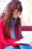 Girl reading a book in autumn park Royalty Free Stock Photo