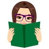 Girl Reading Book. Beautiful brunette girl enjoying reading a very interesting book stock illustration