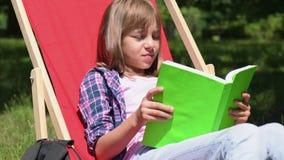 Girl reading book stock video