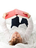 Girl reading book. Girl on bed reading book - education or knowledge concept Royalty Free Stock Photography