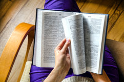 Girl reading the Book. The girl with the Bible Stock Photography