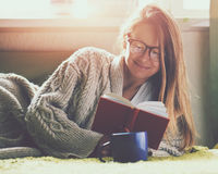 Girl reading book with coffee stock photos
