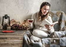 Girl reading a book. Cozy composition of young beautiful girl reading a book ,the concept of leisure and Hobbies Royalty Free Stock Photography