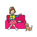Girl reading book and feeding dog Stock Images