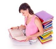 Girl reading  book on floor. Stock Photo