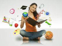 Girl reading book with flying object Royalty Free Stock Photography