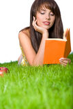 Girl reading book in the grass Stock Photo