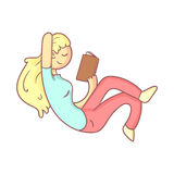 Girl Reading A Book Half Laying Stock Photo