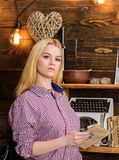 Girl reading book in house of gamekeeper. Girl in casual outfit in wooden vintage interior enjoy poetry. Lady blonde on. Calm face in plaid clothes holds book Stock Photos
