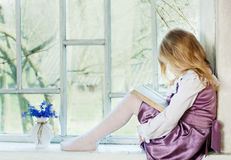 girl reading book indoor Stock Image