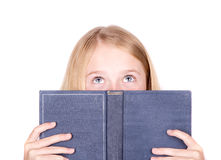 Girl reading book looking up Royalty Free Stock Photos