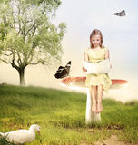 Girl Reading a Book on Mushroom Stock Image