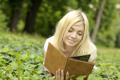 Girl reading a book outdoor. Royalty Free Stock Photo