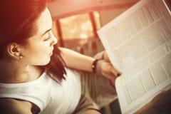 Girl reading book outdoor on the beach Stock Photos
