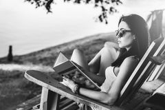 girl reading book outdoor on the beach Royalty Free Stock Photography
