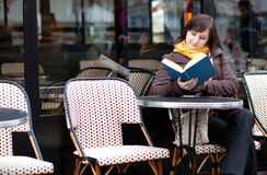 Girl reading a book outdoors Stock Photography