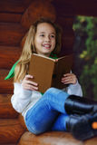 Girl reading a book outdoors Royalty Free Stock Photo