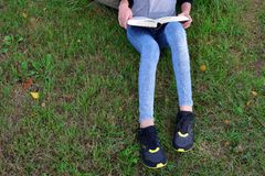 Girl reading book outside royalty free stock images
