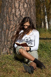 Girl reading the book in the park Royalty Free Stock Image