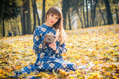 Girl reading book in park Royalty Free Stock Image