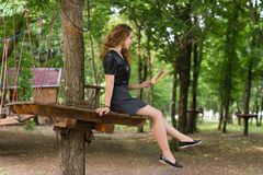 A girl is reading in the park. Stock Photography