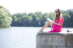 Girl reading a book in  park film effect Stock Image