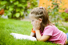 Girl reading a book in the park Royalty Free Stock Images