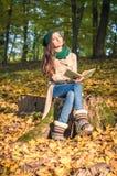 Girl reading a book in the Park Stock Photos
