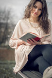 Girl reading a book in park Royalty Free Stock Photography