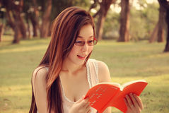 Girl is reading Book Stock Photo