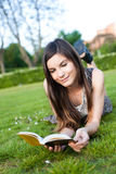 Girl reading a book Royalty Free Stock Photography