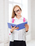 Girl reading book at school Royalty Free Stock Image