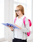 Girl reading book at school Royalty Free Stock Photography