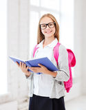 Girl reading book at school Royalty Free Stock Photos