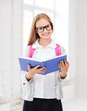 Girl reading book at school Royalty Free Stock Images