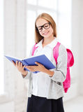 Girl reading book at school Stock Photos