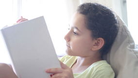 Girl reading a book side view stock footage