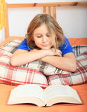 Girl reading a book Royalty Free Stock Images