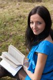 Girl reading book in spring park Royalty Free Stock Photography
