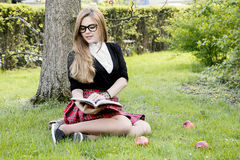 Free Girl Reading Book / Student Reading A Book/ In Park / Stock Photo - 96670640