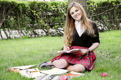 Girl reading book / student reading a book/ in park /. Studing in park, A pretty girl reading a book, Learning in nature, Student, girl student, break between Stock Image