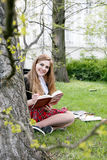 Girl reading book / student reading a book/ in park /. Studing in park, A pretty girl reading a book, Learning in nature, Student, girl student, break between Royalty Free Stock Image