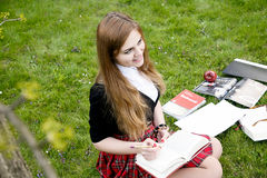 Girl reading book / student reading a book/ in park /. Studing in park, A pretty girl reading a book, Learning in nature, Student, girl student, break between Stock Photography