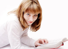 Girl reading a book, studio isolated Royalty Free Stock Photography