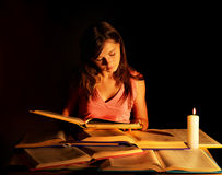 Girl reading  book on table. Royalty Free Stock Photography