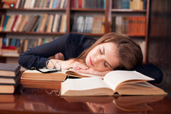 Girl reading book tired and fell asleep Royalty Free Stock Images