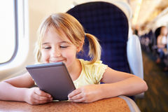 Girl Reading A Book On Train Stock Images