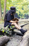 Girl reading a book, turned around Royalty Free Stock Image