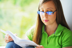 Girl reading book stock photography