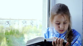 Girl reading a book stock video footage